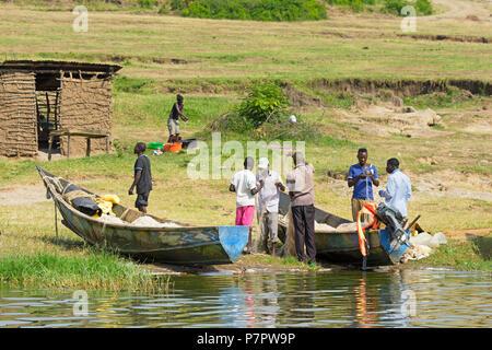 Fishermen Inspecting, Tending their nets,Fishing Village on the Kazinga Channel, Queen Elizabeth National Park, Uganda - Stock Image