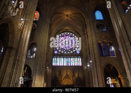 PARIS, FRANCE - OCTOBER 27 2018: Rose Window in the famous Notre Dame de Paris, Gothic Interior of the Cathedral example of Rayonnant architecture - Stock Image