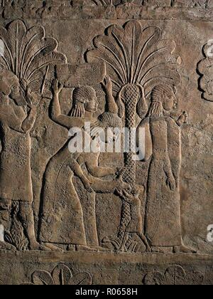 3663. WOMEN AND CHILDREN BEING DRIVEN AWAY FROM A CITY CAPTURED BY THE ASSYRIANS.  PIC: A WOMAN (POSSIBLY HIS MOTHER) GIVING WATER TO A CHILD FROM A WATER SKIN.  RELIEF FROM ASHURBANIPAL'S PALACE IN NINVEH, C. 7TH. C. BC - Stock Image