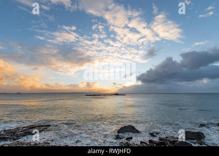 Mousehole, Cornwall, UK. 7th Mar, 2019. UK Weather. A noticeably cooler start to the day at Sunrise, as the sun rises over Mousehole. Credit: Simon Maycock/Alamy Live News - Stock Image