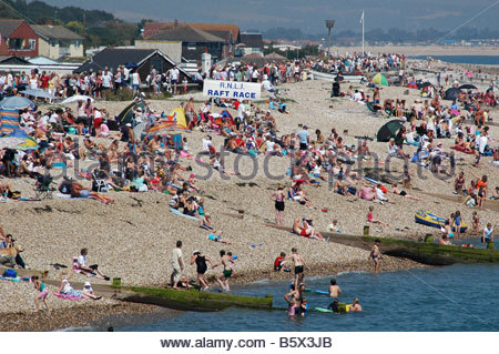 Spectators on the beach enjoying entertainments on the sea at Lifeboat Launch Day Selsey West Sussex England UK - Stock Image