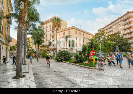 Italians enjoy an early evening passeggiata on the Corso Umberto, main street through the coastal city of Brindisi, Italy, in Southern Puglia region - Stock Image