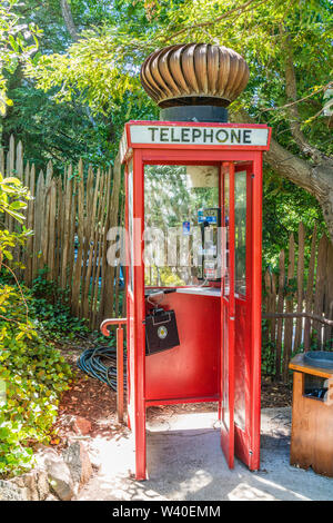 Highly unusual and humorous British Red Telephone Box with a huge turbine wind ventilator on top at Nepenthe restaurant in Big Sur, California. - Stock Image