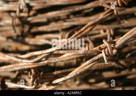Barbwire fencing in a bundle. - Stock Image