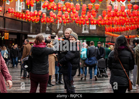 London, UK, 10 February, 2019. Londoner family clicking photo with her mobile during Chinese New year celebration at China Town, SOHO, London, UK. Credit: Harishkumar Shah/Alamy Live News - Stock Image