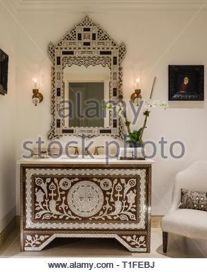 Mirror over washbasin in Arabic bathroom - Stock Image