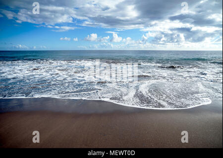 Beautiful ocean view with thin dark clouds in Tenerife, Canary Islands - Stock Image