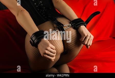 Adult sex games. Submissive girl in bondage prepare for punishment. - Image - Stock Image