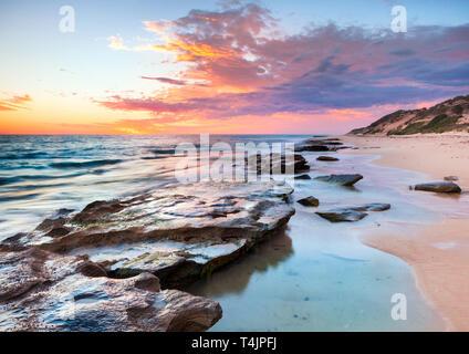Limestone coastline and rock pools at Burns Beach at sunset. Perth, WA - Stock Image