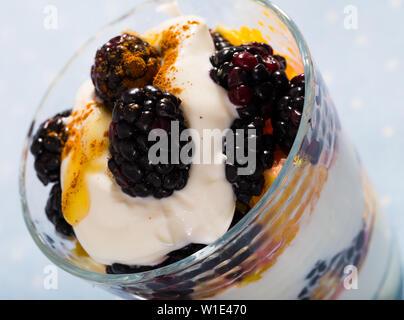 Healthy dessert with yogurt, fresh blueberries and orange - Stock Image