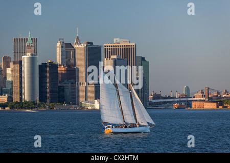 Lower Manhattan Skyline, Sailing Boat, East River,  New York - Stock Image