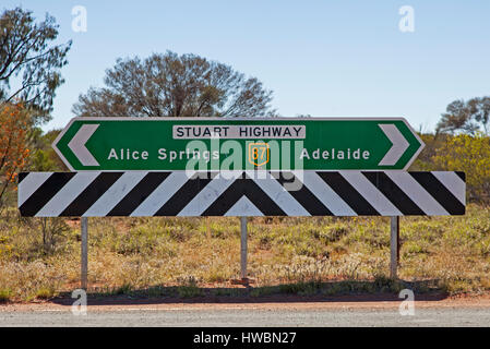 Direction Sign at the Lasseter Highway and Stuart Highway Crossing, Northern Territory, Australia - Stock Image