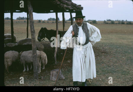 Shepherd in his outfit in the Puszta, Hungary. - Stock Image