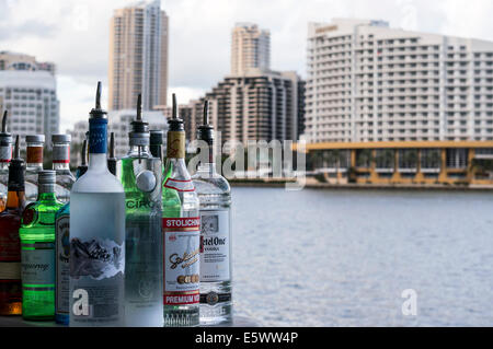 Liquor bottles sit on the patio bar of Crazy About You restaurant on Biscayne Bay in Brickell area of Miami, Florida. - Stock Image