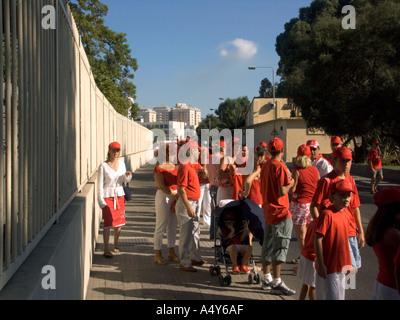 Gibraltar Tercentenary Celebrations human chain hold held link linked hands enjoy Gibraltar Tercentenary Celebrations celebrate - Stock Image