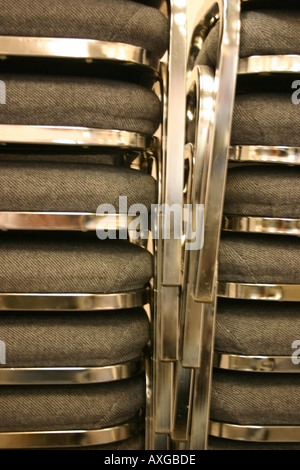 Chair on top of chair create a shiny ribcage of sorts. - Stock Image