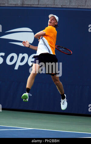 New York, United States. 29th Aug, 2018. Flushing Meadows, New York - August 29, 2018: US Open Tennis: Denis Shapovalov of Canada goes airborne as he strikes a forehand during his second round match to Andreas Seppi of Italy at the US Open in Flushing Meadows, New York. Shapovalov won the match in five sets to advance to the third round. Credit: Adam Stoltman/Alamy Live News - Stock Image