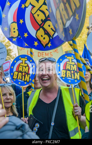 London, UK. 20th October 2018. A woman holds 'I am BRIN' signs on Whitehall at the end of the People's Vote March calling for a vote to give the final say on the Brexit deal or failure to get a deal. They say the new evidence which has come out since the referendum makes it essential to get a new mandate from the people to leave the EU. With so many on the march the crowding meant many failed to reach Parliament Square and came to a halt in Whitehall. Peter Marshall/Alamy Live News - Stock Image