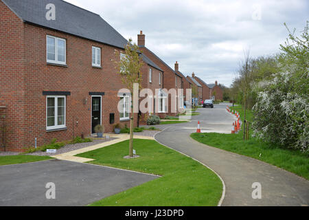 Goldings Road, a Taylor Wimpey development in the north Oxfordshire village of Hook Norton. Constructed in 2015/16 - Stock Image