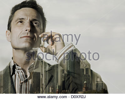 Businessman double exposed with city scene - Stock Image