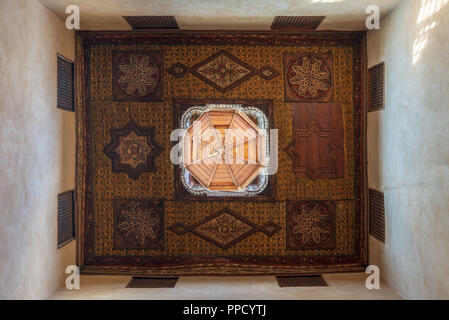 Ottoman era decorated wooden ceiling with floral pattern decorations and wooden dome at historic House of Egyptian Architecture - Stock Image