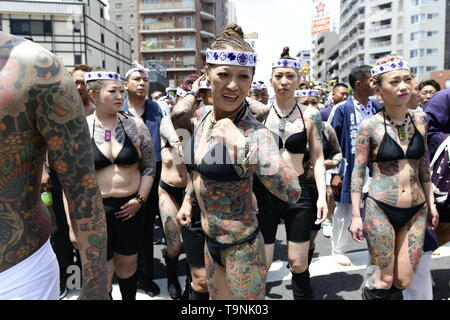 TOKYO, JAPAN - MAY 18: Heavily tattooed Japanese men and women walk in the street of Asakusa during 'Sanja Matsuri' on May 18, 2019 in Tokyo, Japan. A boisterous traditional mikoshi (portable shrine) is carried in the streets of Asakusa to bring goodluck, blessings and prosperity to the area and its inhabitants. (Photo: Richard Atrero de Guzman/ AFLO) - Stock Image