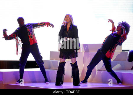 Rita Ora performs on stage during a concert hosted by Sentebale in Hampton Court Palace in East Molesey, to raise awareness and vital funds for the Duke's charity, Sentebale, which helps young people in southern Africa affected by HIV. - Stock Image