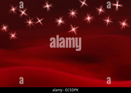 glittering stars on soft red background - Stock Image