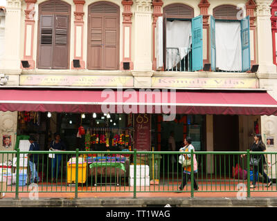 Shop and first floor accommodation in a styled house in the Indian ethnic district Little India in the city state of Singapore on a Saturday morning, - Stock Image
