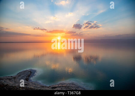 Amazing sunset over Dead sea, view from Jordan to Israel and Mountains of Judea. Madaba governorate and Karak governorate. Reflection of sun, skies an - Stock Image