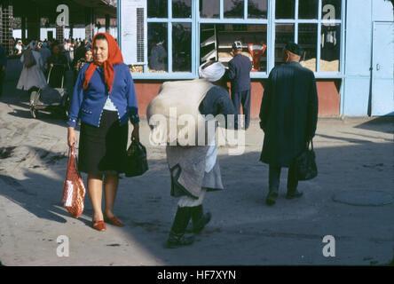 People at a market place; Samarkand, Uzbekistan, former USSR. - Stock Image