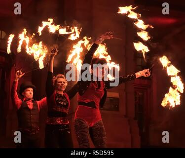 30th, November, 2018. Glasgow, Scotland, UK, Europe. West End Festival. A trio of fire spinners at the St Andrew's Day Torchlight Parade as part of Event Scotland's Winter events programme. - Stock Image