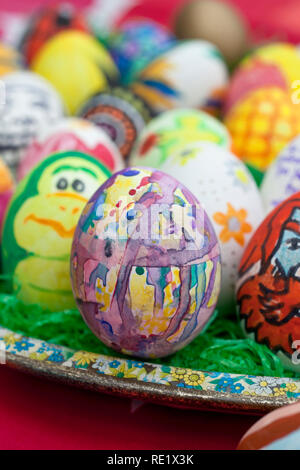 Detail of colorful, painted Easter eggs with different forms and animals. - Stock Image