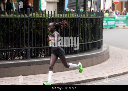 Elite Female athlete, Vivian Cheruiyot  from Kenya, competing in the 2019 London Marathon. She went on to finished 2nd in a time of 02:20:14 - Stock Image