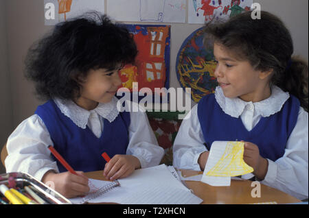 two little girls in class - Stock Image