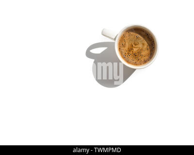 White coffee cup on white table top view isolated on white. Sparse composition with copy space - Stock Image