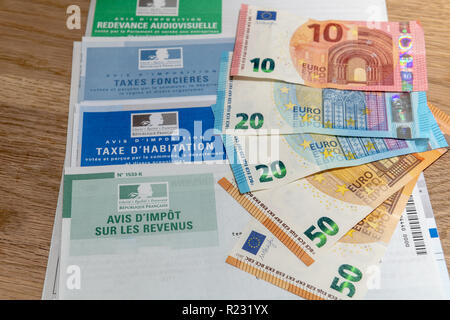 Paris, France - November 18, 2016 : The various French taxes return and banknotes in euros - Stock Image
