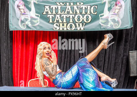 Skibbereen, West Cork, Ireland. 20th Oct, 2018. Pole Dancer Racheal Palmer from Galway, dressed as a mermaid, strikes a pose during the tattoo show. The show has been attended by many tattooists from across Ireland and the North. The event finishes tomorrow. Credit: Andy Gibson/Alamy Live News. - Stock Image