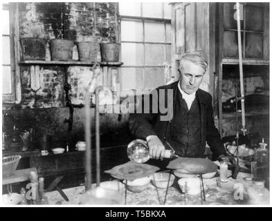 Thomas Edison, (1847-1931), half-length portrait, working in his chemical laboratory, c. 1905 - Stock Image