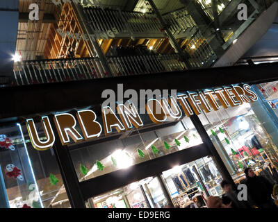 Urban Outfitters shopfront manchester at night - Stock Image