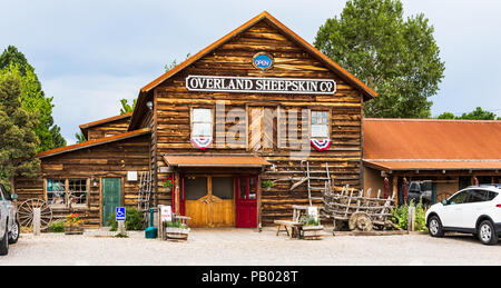 TAOS, NM, USA-5 JULY 18:  The Overland Sheepskin Co, a leather clothing dealer, in t he Overland compound, just north of Taos near Taos Mountain. - Stock Image