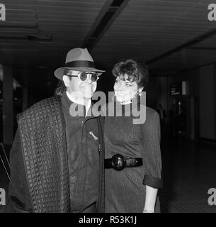 Elton John with his wife Renate arriving from Los Angeles at London Airport. 17th October 1986. - Stock Image