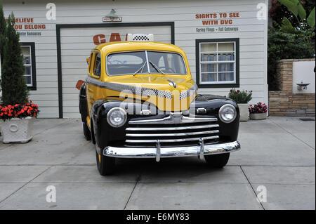 Vintage Ford Yellow cab taxi. Disney's Hollywood Studios, Orlando, Florida, USA - Stock Image