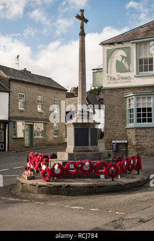 Kington, Herefordshire, UK. The town war memorial with poppy wreaths, on Remembrance Sunday - Stock Image