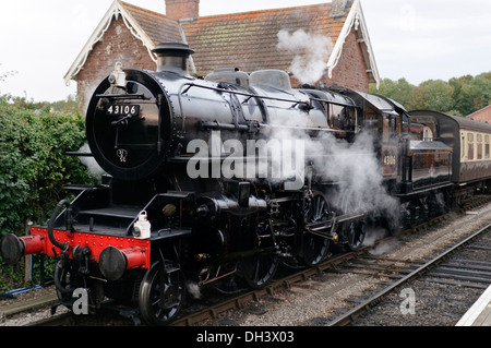 Ivatt (Mucky Duck) class 4MT number 43106 Steam Locomotive standing at Bishops Lydeard station on the West Somerset Railway - Stock Image
