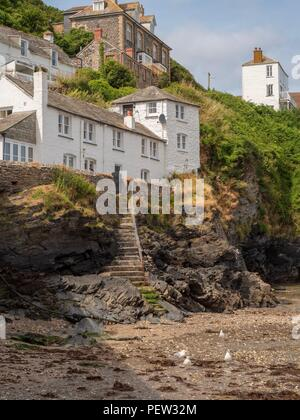 Houses built on the cliff at the harbour for Port Isaac in Cornwall - Stock Image