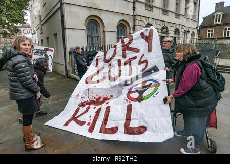 London, UK. 19th Dec, 2018. DPAC lift up their large banner 'Tory Cuts Kill' at the protest together with the WOW campaign supporting the parliamentary debate due later in the day on the cumulative impact of the cuts on the lives of disabled people. They say the government cuts and changes in benefits, along with inappropriate benefit sanctions, have had a disproportionate effect on disabled people, resulting in great hardship, denying people their rights and many deaths. Credit: Peter Marshall/Alamy Live News - Stock Image