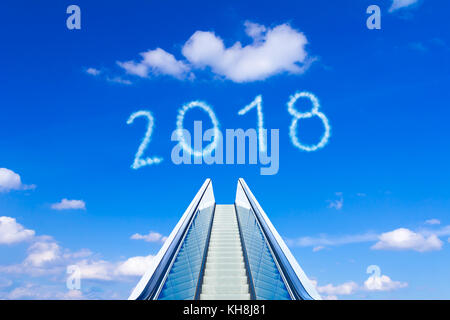 Reaching the new year 2018 on a moving stairway or escalator. Concept photo for success and reaching goals. - Stock Image