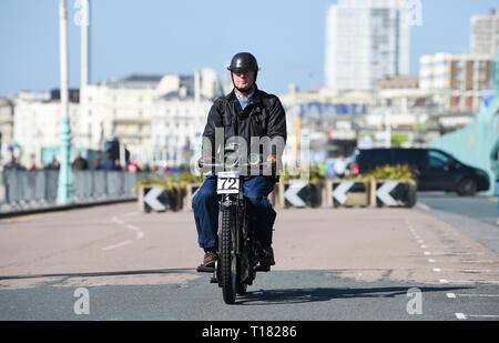 Brighton, UK. 24th March 2019. Clive Boothman on his 1910 Rex finishes the 80th Anniversary Pioneer Run for pre 2015 veteran motorcycles in Brighton. The run organised by the Sunbeam Motor Cycle Club begins on the Epsom Downs in Surrey and finishes on Madeira Drive on Brighton seafront. Credit: Simon Dack/Alamy Live News - Stock Image