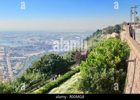 Barcelona, Spain, October 2018. Looking out from Castell / Castle Mont Juic across the Port of Barcelona on a hot bright afternoon. - Stock Image